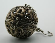 A Chinese pierced ball censer with chain for suspension. 5 cm diameter.