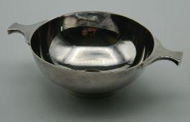 A silver quaich, hallmarked for Edinburgh 1964. 13 cm wide. 111.9 grammes.