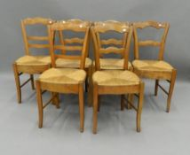 A matched set of six Victorian rush seated country chairs. 39 cm wide.