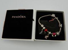 A boxed Pandora bracelet. Approximately 17 cm long.