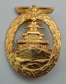 A reproduction Nazis gilt high fleet badge.