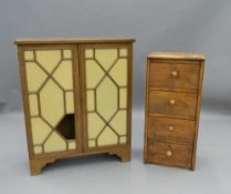 A small early 20th century oak bank of drawers and a glazed mahogany cabinet. The former 81 cm high.