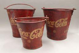 A set of Coca-Cola buckets