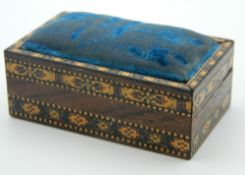 A Victorian Tunbridge Ware pin cushion/box. 7 cm long.