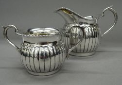 A 925 silver sugar bowl and a matching cream jug. The jug 9 cm high. 9.6 troy ounces.