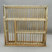 A 19th century pine country house plate rack. 114.5 cm wide. The property of Germaine Greer.