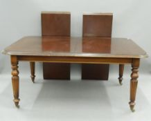 A reproduction mahogany two-leaf extending dining table. 160 cm long extended.