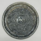 An Eastern embossed silver tray. 26 cm diameter. 11.9 troy ounces.