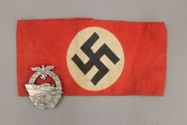 A Kriegsmarine badge and armband.