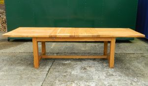 A modern two-leaf extending dining table. 300 cm long extended x 90 cm wide.