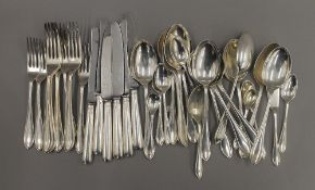 A quantity of silver flatware. 49 troy ounces of weighable silver.