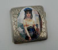 A silver cigarette case depicting a semi-clothed lady. 7.5 cm wide.