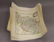 A quantity of various maps. 39.5 cm high.