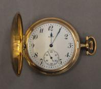 A gold plated pocket watch. 4.5 cm diameter.