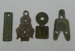 Four Chinese bronze archaic style pendants. The largest 6.5 cm high.