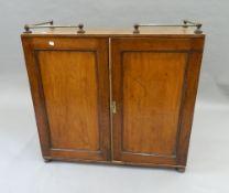 A 19th century mahogany side cupboard. 94 cm wide.