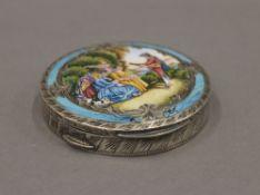 A silver enamel compact. 7 cm diameter.