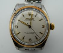 A steel and gold bevel Rolex wristwatch. 3.5 cm wide.