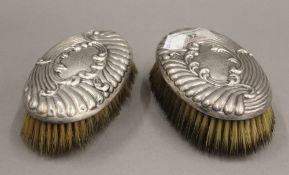 Two silver brushes. Each 13 cm long.