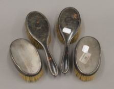 Two silver brushes,