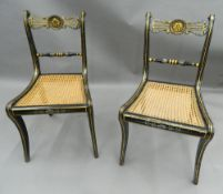 A pair of 19th century gilded ebonised cane seated side chairs. 46 cm wide.