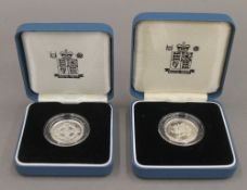 Two solid silver boxed £1 coins with certificates.