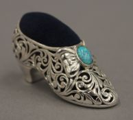 A silver shoe pin cushion set with an opal. 5 cm wide.