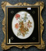 A framed embroidered floral panel. 49 x 54 cm overall.