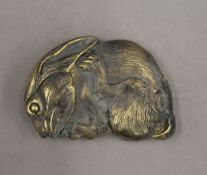 A brass vesta formed as a rabbit. 6 cm wide.