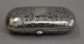 A Russian silver niello cigarette case. 8.5 cm wide.