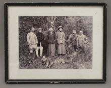 An Edwardian photograph of a tiger shooting party, framed and glazed. 26.5 x 21 cm overall.