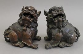 A pair of Chinese bronze dogs-of-fo. 15.5 cm high.
