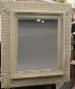 A large decorative white framed mirror. 84 cm wide.