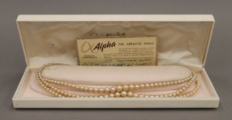 A three strand simulated pearl necklace