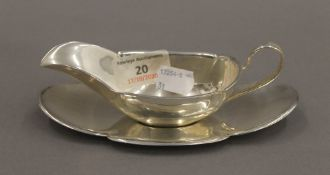 A small sterling silver sauce boat on stand. The stand 16 cm long. 137.9 grammes.
