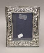 A silver photograph frame, hallmarked London 1968. 20 cm high.