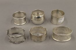 A quantity of silver napkin rings. 186.1 grammes.