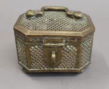 A Chinese brass cricket cage