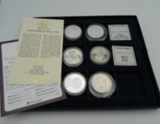 A quantity of silver proof coins, etc.