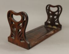 A Victorian rosewood book slide. 30.5 cm closed.