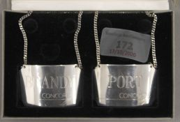A boxed pair of Concorde silver decanter labels