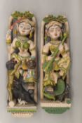 A pair of Indian painted figural carvings. The largest 72 cm high.