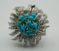 A 9 ct white gold diamond and turquoise floral target ring. Ring Size N/O.