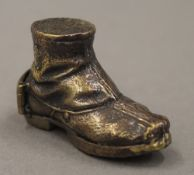 A brass vesta formed as a boot. 5 cm long.