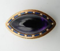 An unmarked gold amethyst and blue enamelled brooch/pendant. 3.5 cm wide. 7 grammes total weight.