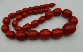 A string of large vintage amber beads. 67 cm long.