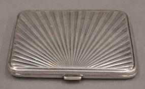 A Danish silver plated sunburst cigarette case. 8 cm wide. 62.8 grammes.