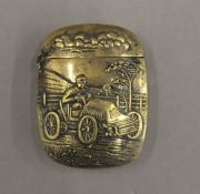 A motoring brass vesta. 5.5 cm high.