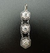An Art Deco platinum diamond three section pendant. 3.5 cm high.