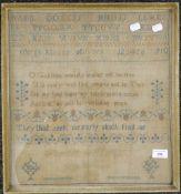 A Victorian needlework sampler, dated 1852, framed and glazed. 40.5 x 44 cm.